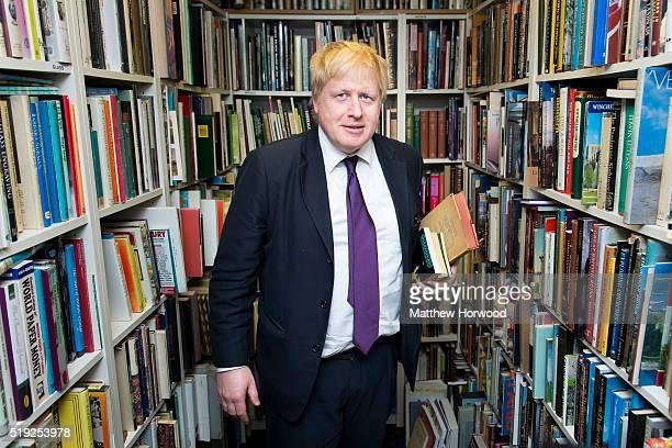 Boris Johnson poses for a picture in Andrew Morton's bookshop on April 5 2016 in Brecon Wales The Mayor of London Boris Johnson is in Wales for a day...