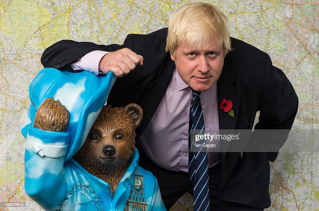 <a gi-track='captionPersonalityLinkClicked' href=/galleries/search?phrase=Boris+Johnson&family=editorial&specificpeople=209016 ng-click='$event.stopPropagation()'>Boris Johnson</a> stands with his 'Bear of London' Paddington Bear statue during the launch of The Paddington Trail at City Hall on November 3, 2014 in London, England.