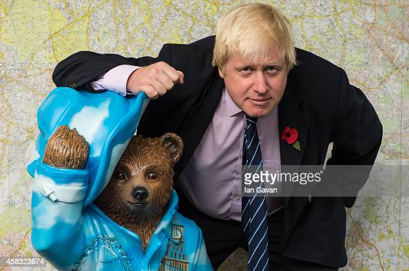 Boris Johnson stands with his 'Bear of London' Paddington Bear statue during the launch of The Paddington Trail at City Hall on November 3 2014 in...