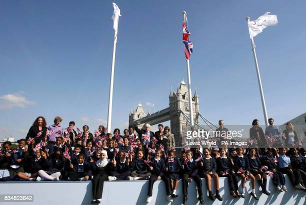 Boris Johnson Tessa Jowell and Lord Coe with children from the Tower Bridge Primary School outside City Hall where flags were raised to formally mark...
