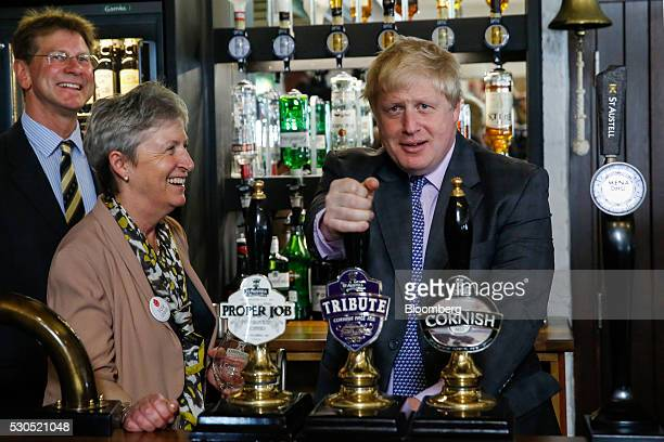 Boris Johnson the former mayor of London pulls a pint of the ale at the St Austell Brewery with Gisela Stuart lawmaker for the Labour Party during...