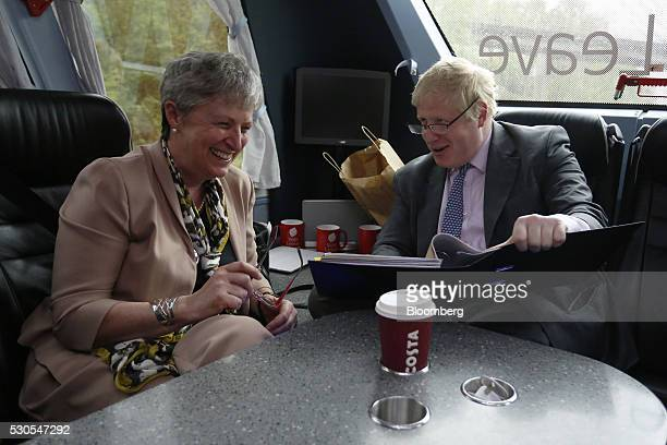 Boris Johnson the former mayor of London right speaks with Gisela Stuart lawmaker for the Labour Party on board the Vote Leave Bus during the first...