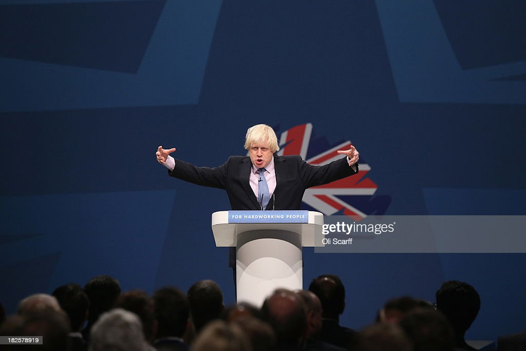 <a gi-track='captionPersonalityLinkClicked' href=/galleries/search?phrase=Boris+Johnson&family=editorial&specificpeople=209016 ng-click='$event.stopPropagation()'>Boris Johnson</a>, the Mayor of London, delivers his speech in the Main Hall of Manchester Central on the third day, and penultimate day, of the Conservative Party Conference on October 1, 2013 in Manchester, England. David Cameron has unveiled a Government pilot scheme for GP surgeries to open from 8am until 8pm seven days, backed by 50 million GBP of funding.