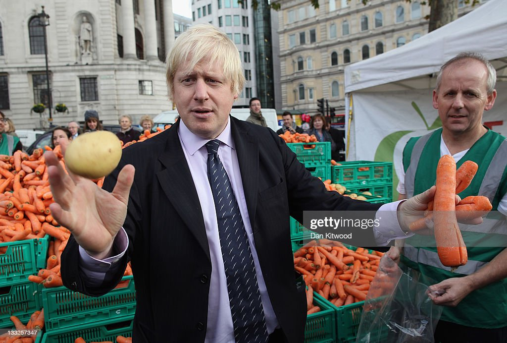 Boris Johnson, the Mayor of London holds oddly shaped vegetables at a free food event on November 18, 2011 in London, England. The 'Feed The 5,000' free lunch event took place in London's Trafalgar Square and was aimed at raising awareness of the financial impact of throwing good food away.