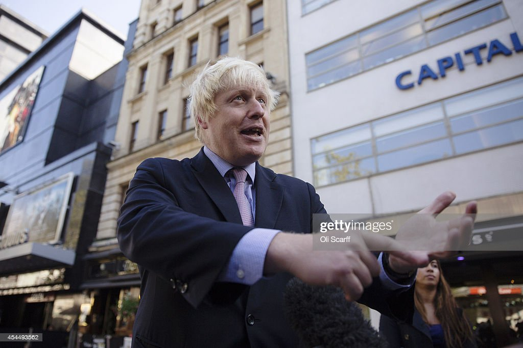 <a gi-track='captionPersonalityLinkClicked' href=/galleries/search?phrase=Boris+Johnson&family=editorial&specificpeople=209016 ng-click='$event.stopPropagation()'>Boris Johnson</a>, the Mayor of London, is interviewed in Leicester Square following his regular 'Ask Boris' phone-in show on LBC talk radio on September 2, 2014 in London, England. Plans for a major new airport to be constructed on an island in the Thames estuary, which have been championed by Mr Johnson and dubbed 'Boris Island', were rejected in a report by the Airports Commission.