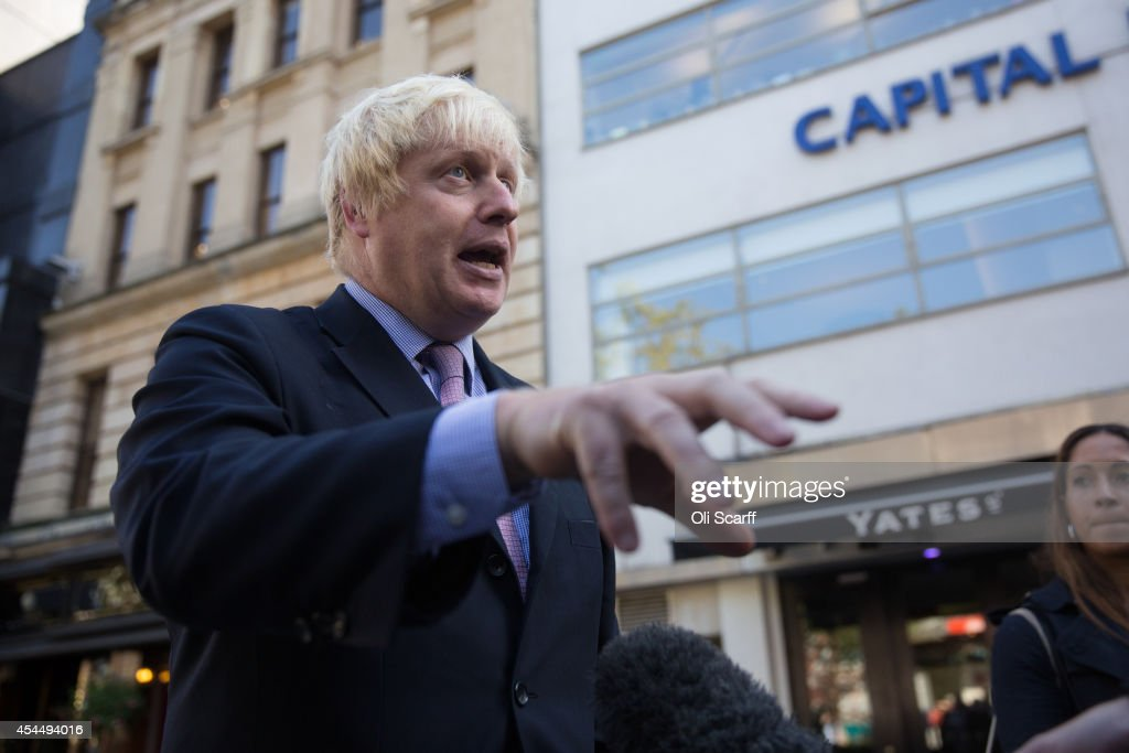 <a gi-track='captionPersonalityLinkClicked' href=/galleries/search?phrase=Boris+Johnson&family=editorial&specificpeople=209016 ng-click='$event.stopPropagation()'>Boris Johnson</a>, the Mayor of London, is interviewed in Leicester Square following his regular 'Ask Boris' phone-in show on LBC talk radio on September 2, 2014 in London, England. Plans for a major new airport to be constructed on an island in the Thames estuary, which have been championed by Mr Johnson and dubbed 'Boris Island', have rejected in a report by the Airports Commission.