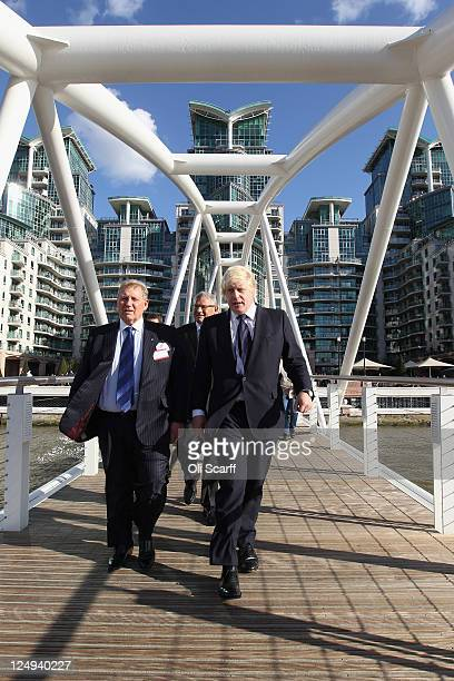 Boris Johnson the Mayor of London is joined by Tony Pidgley the cofounder and Group Chairman of Berkeley as they cross a bridge to unveil a new pier...