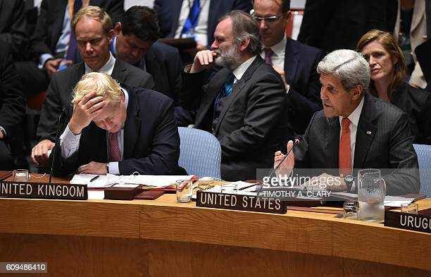 Boris Johnson UK foreign secretary and Sir Tim Barrow look on as US Secretary of State John Kerry speaks during a Security Council Meeting September...