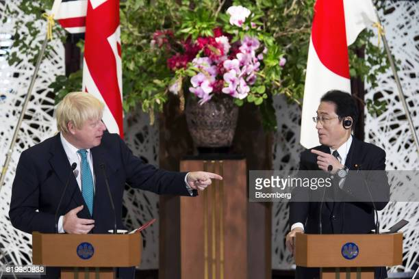 Boris Johnson UK foreign secretary left and Fumio Kishida Japan's foreign minister gesture while delivering a joint statement after their meeting in...