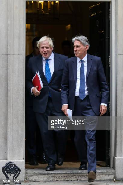 Boris Johnson UK foreign secretary left and Philip Hammond UK chancellor of the exchequer leave number 10 Downing Street following a special cabinet...