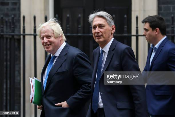 Boris Johnson UK foreign secretary left and Philip Hammond UK chancellor of the exchequer center leave number 10 Downing Street following a special...