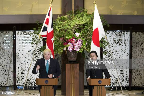 Boris Johnson UK foreign secretary left delivers a joint statement as Fumio Kishida Japan's foreign minister listens after their meeting in Tokyo...