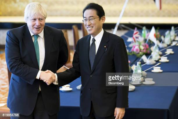 Boris Johnson UK foreign secretary left shakes hands with Fumio Kishida Japan's foreign minister before a meeting in Tokyo Japan on Friday July 21...