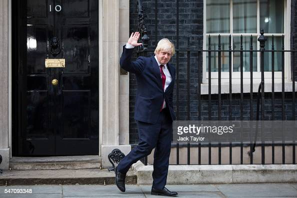 Boris Johnson waves as he leaves Downing Street after being appointed Foreign Secretary on July 13 2016 in London England The UK's New Prime Minister...