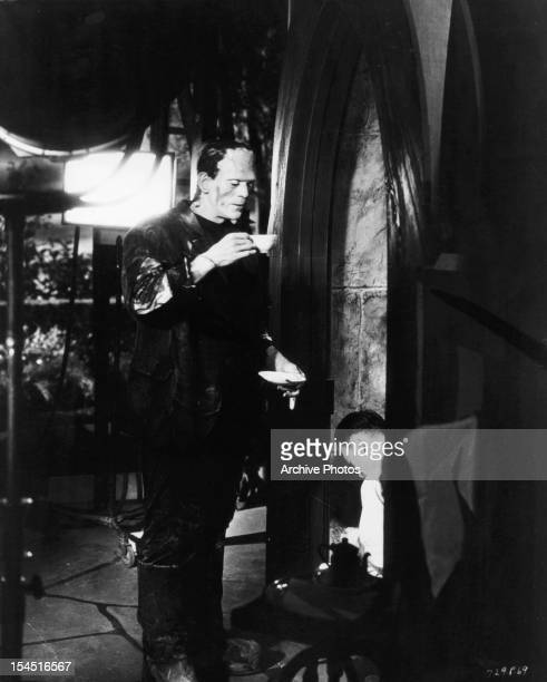 Boris Karloff enjoying cup of tea during wardrobe fitting in between scenes from the film 'Frankenstein' 1931