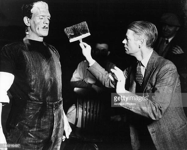 Boris Karloff with cigarette is dirtied by director James Whale in between scenes from the film 'Frankenstein' 1931