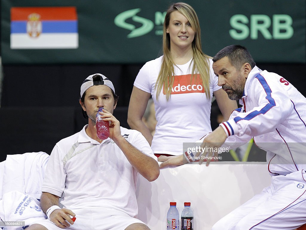 Boris Pasanski (L) and team captain Bogdan Obradovic (R) of Serbia speak during the third day of the Davis Cup singles first round match between Belgium and Serbia, at Spirou dome February 03, 2013 in Charleroi, Belgium.