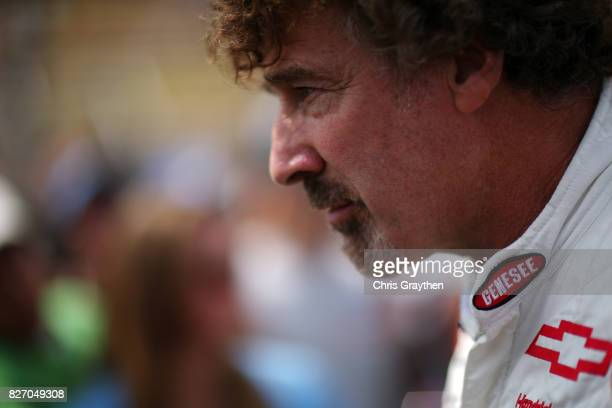 Boris Said driver of the Genesee Beer/Genesee Light Chevrolet stands on the grid prior to the Monster Energy NASCAR Cup Series I Love NY 355 at The...