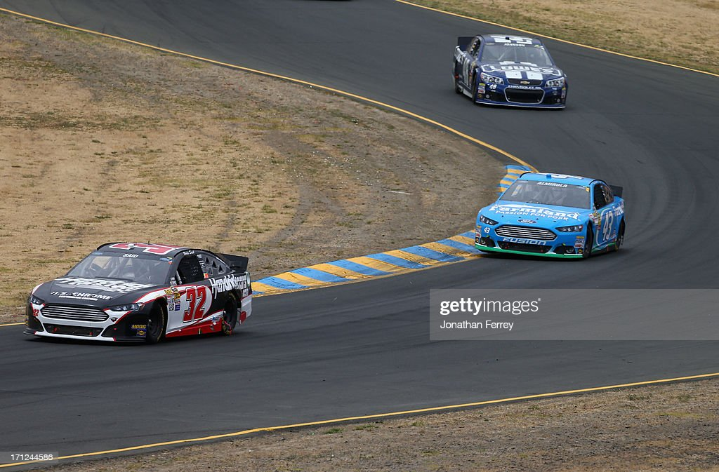 Boris Said, driver of the #32 Hendrickcars.com Ford, leads Aric Almirola, driver of the #43 Farmland Ford, during the NASCAR Sprint Cup Series Toyota/Save Mart 350 at Sonoma Raceway on June 23, 2013 in Sonoma, California.