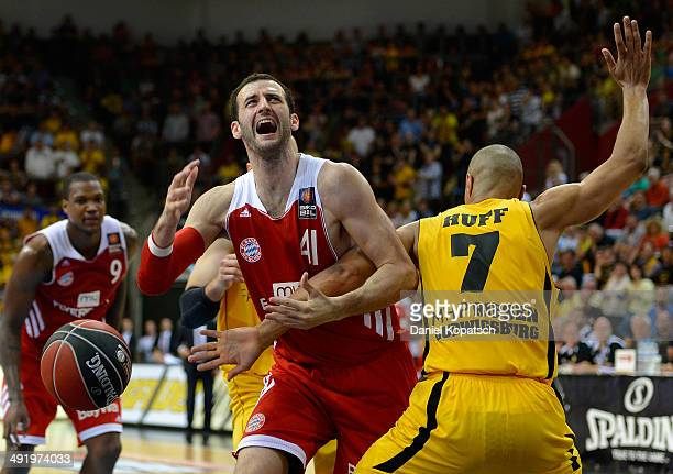 Boris Savovic of Muenchen is challenged by Shawn Huff of Ludwigsburg during the Beko BBL Playoffs semifinal match between MHP RIESEN Ludwigsburg and...