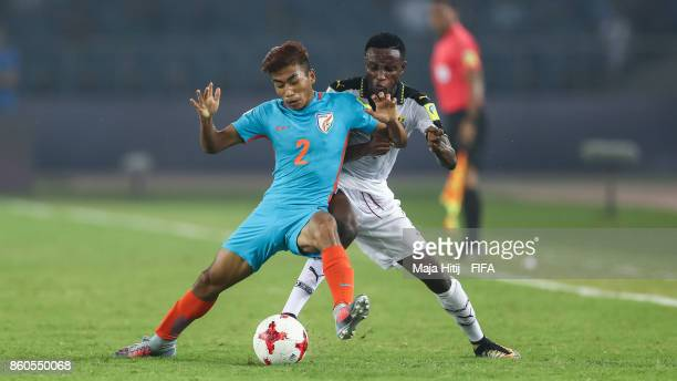 Boris Thangjam of India and Edmund ArkoMensah of Ghana battle for the ball during the FIFA U17 World Cup India 2017 group A match between Ghana and...