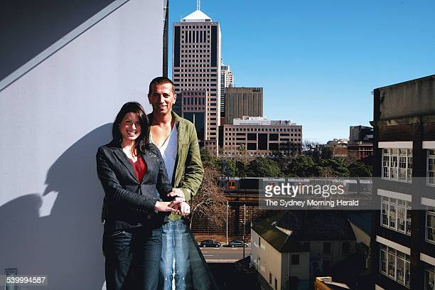 Boris Tosic and Naomi Phillips on the verandah of their new Surry Hills apartment Sydney 9 August 2006 SMH Picture by SAHLAN HAYES