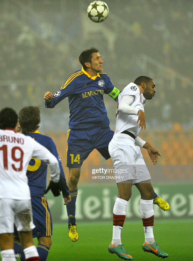 Borisov's Artem Radkov (C) fights for the ball against LOSC Lille's Ronny Rodelin (R) during their Champions League Group F football match in Minsk, on November 20, 2012.