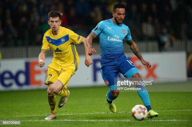Borisov's defender from Belarus Aleksey Rios and Arsenal's forward from England Theo Walcott vie for the ball during the UEFA Europa League Group H...