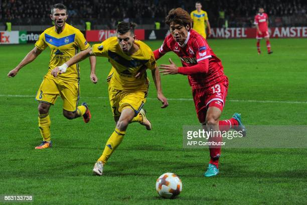 Borisov's defender from Belarus Aleksey Rios and FC Cologne's forward from Japan Yuya Osako vie for the ball during the UEFA Europa League Group H...