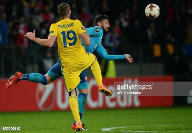 Borisov's defender from Serbia Nemanja Milunovic and Arsenal's forward from France Olivier Giroud vie for the ball during the UEFA Europa League...