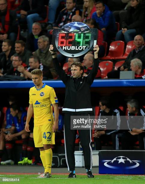 Borisov's Maksim Volodko waits to be substituted on to the pitch as the official holds up the substitution electronic board