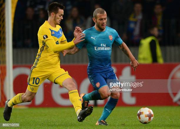 Borisov's midfielder from Montenegro Mirko Ivanic and Arsenal's midfielder from England Jack Wilshere vie for the ball during the UEFA Europa League...