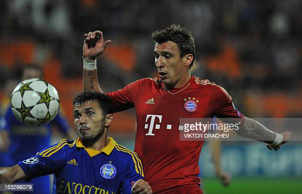 Borisov's Serbian defender Marko Simic fights for the ball against Bayern Munich's Croatian striker Mario Mandzukic during on their Champions League...