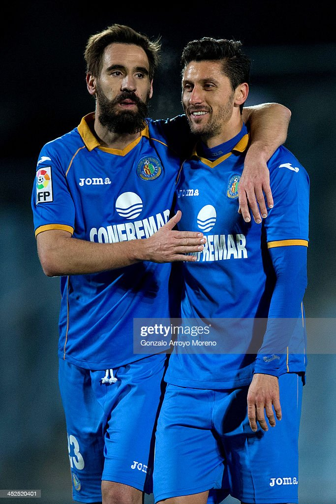 Borja Fernandez Fernandez (L) of Getafe CF celebrates with his team-mate <a gi-track='captionPersonalityLinkClicked' href=/galleries/search?phrase=Ciprian+Marica&family=editorial&specificpeople=2178476 ng-click='$event.stopPropagation()'>Ciprian Marica</a> (R) after the La Liga match between Getafe CF and Levante UD at Coliseum Alfonso Perez on November 29, 2013 in Getafe, Spain.