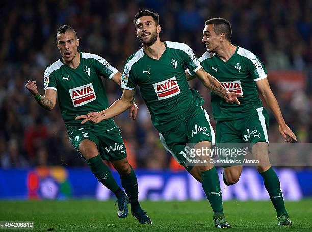 Borja Gonzalez Tomas 'Baston' of Eibar celebrates scoring his team's first goal with Simone Verdi and Gonzalo Escalante during the La Liga match...