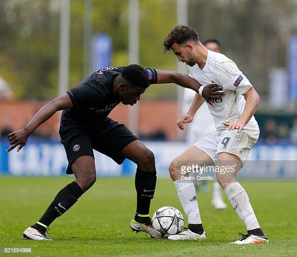 Borja Mayora of Real Madrid duels for the ball with Felix Eboa Eboa of Paris Saint Germain during the UEFA Youth League semi final match between Real...