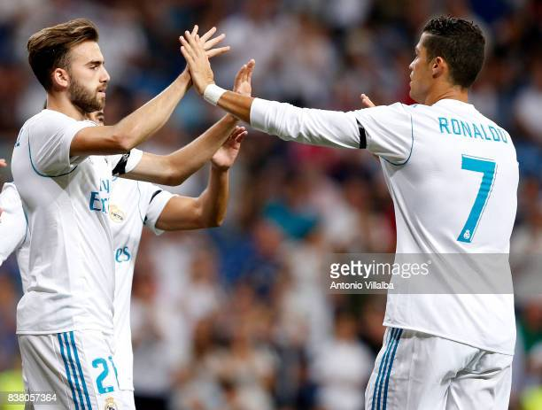 Borja Mayoral and Cristiano Ronaldo of Real Madrid celebrates after scoring the first goal during the Trofeo Santiago Bernabeu match between Real...