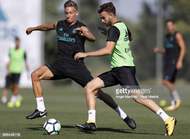Borja Mayoral and Marcos Llorente of Real Madrid in action during a training session at Valdebebas training ground on August 19 2017 in Madrid Spain