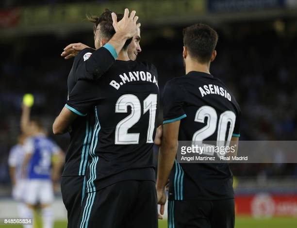 Borja Mayoral of Real Madrid celebrates with Gareth Bale their team's second goal during the La Liga match between Real Sociedad and Real Madrid CF...