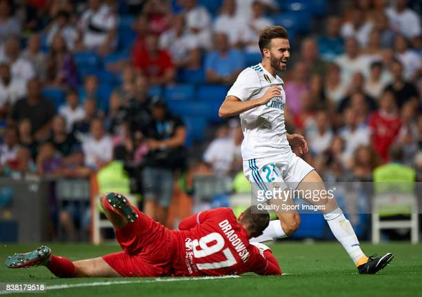 Borja Mayoral of Real Madrid competes for the ball with Bartlomiej Dragowski of Fiorentina during the Trofeo Santiago Bernabeu match between Real...