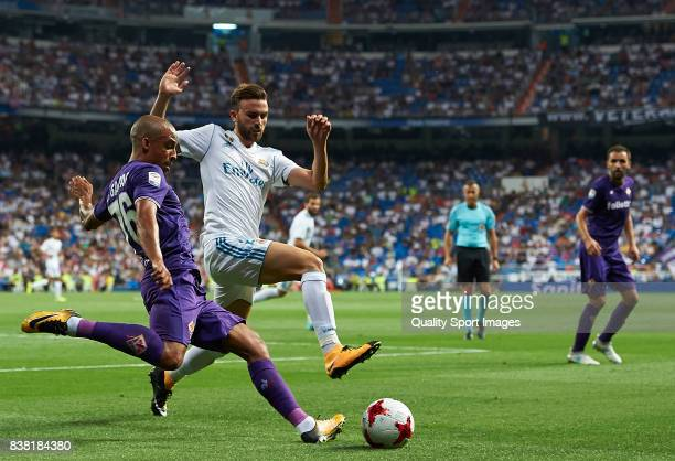 Borja Mayoral of Real Madrid competes for the ball with Bruno Gaspar of Fiorentina during the Trofeo Santiago Bernabeu match between Real Madrid and...