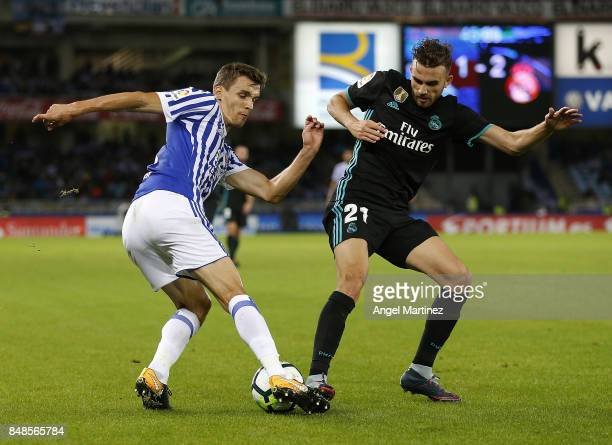Borja Mayoral of Real Madrid competes for the ball with Diego Llorente of Real Sociedad during the La Liga match between Real Sociedad and Real...