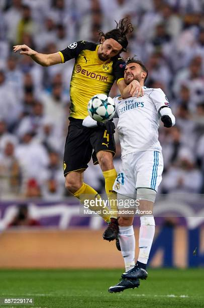 Borja Mayoral of Real Madrid competes for the ball with Neven Subotic of Borussia Dortmund during the UEFA Champions League group H match between...