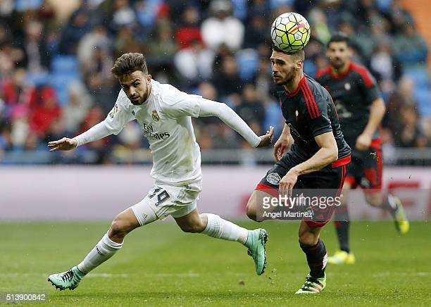 Borja Mayoral of Real Madrid competes for the ball with Sergi Gomez of Celta Vigo during the La Liga match between Real Madrid CF and Celta Vigo at...