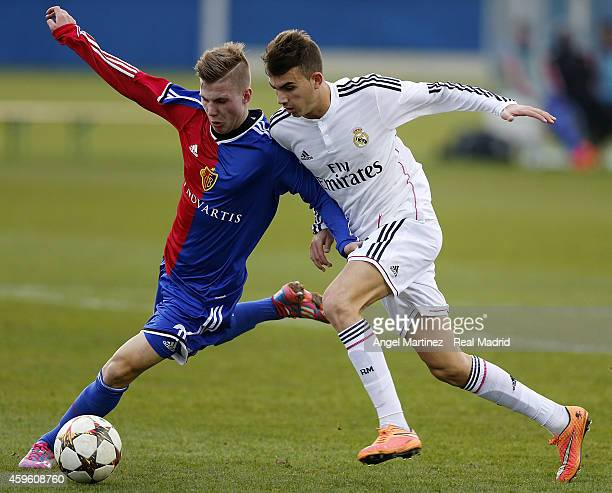 Borja Mayoral of Real Madrid competes for the ball with Tobias Mumenthaler of FC Basel 1893 during the UEFA Youth League match between FC Basel 1893...