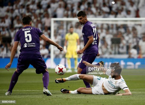 Borja Mayoral of Real Madrid in action against Milan Badelj and German Pezzella of Fiorentina during a Santiago Bernabeu Cup soccer match between...