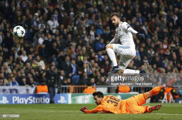 Borja Mayoral of Real Madrid scores the opening goal past Roman Burki of Borussia Dortmund during the UEFA Champions League group H match between...