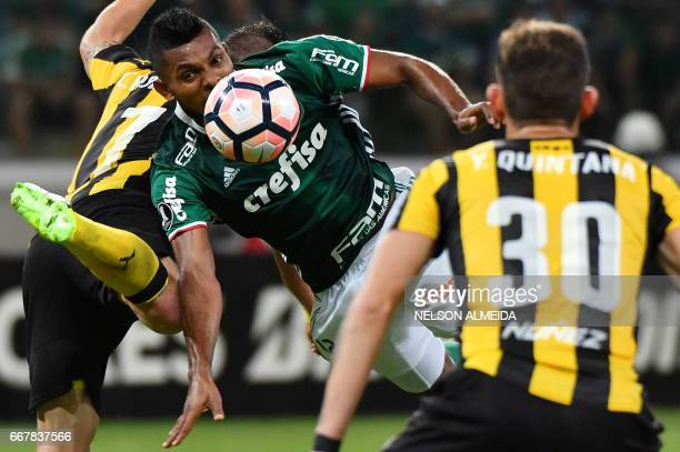 Borja of Brazil´s Palmeiras vies for the ball with Cristian Rodriguez of Uruguay's Penarol during their 2017 Copa Libertadores football match held at...