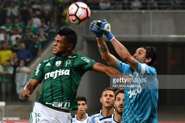 Borja of Brazil's Palmeiras vies for the ball with goalkeeper Cristian Lucchetti of Argentina's Atletico Tucuman during their 2017 Copa Libertadores...
