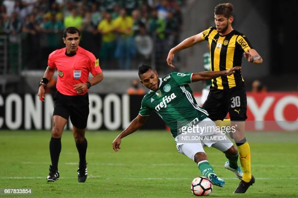 Borja of Brazil´s Palmeiras vies for the ball with Yefferson Quintana of Uruguay's Penarol during their 2017 Copa Libertadores football match held at...